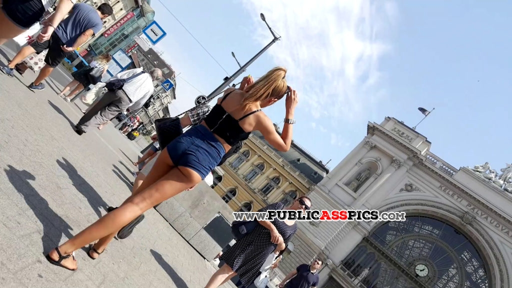 Awesome young little ass in shorts on city square